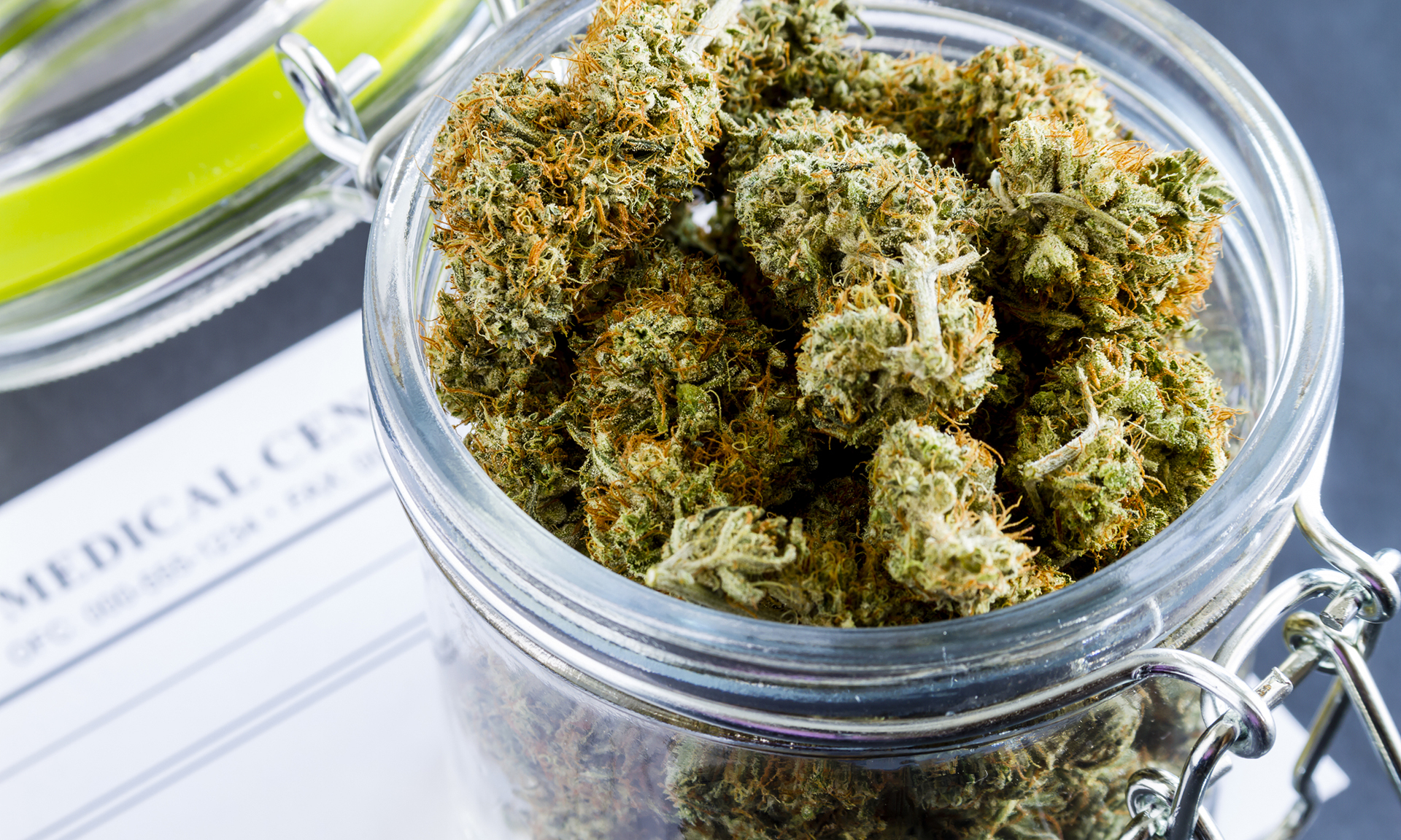 Cannabis buds in a glass container