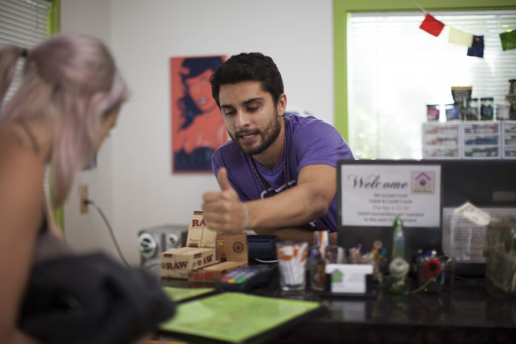 Charlie the Herbs House budtender selling Leafly GG (f.k.a Gorilla Glue) pre-rolls for the Thrift Store Cannabis Challenge