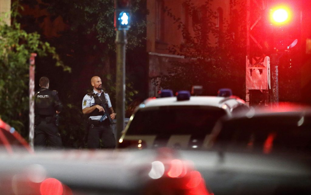 Danish police officer on patrol near Christiania in Copenhagen, Denmark, late night Wednesday, Aug. 31, 2016. Police say they have shot and critically wounded an armed Danish man following an earlier Copenhagen shootout that left two officers and a bystander wounded. (Jens Dresling/ Polfoto via AP)