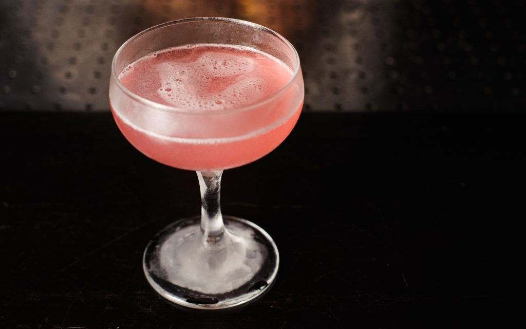 Cosmopolitan pink cocktail on top of bar