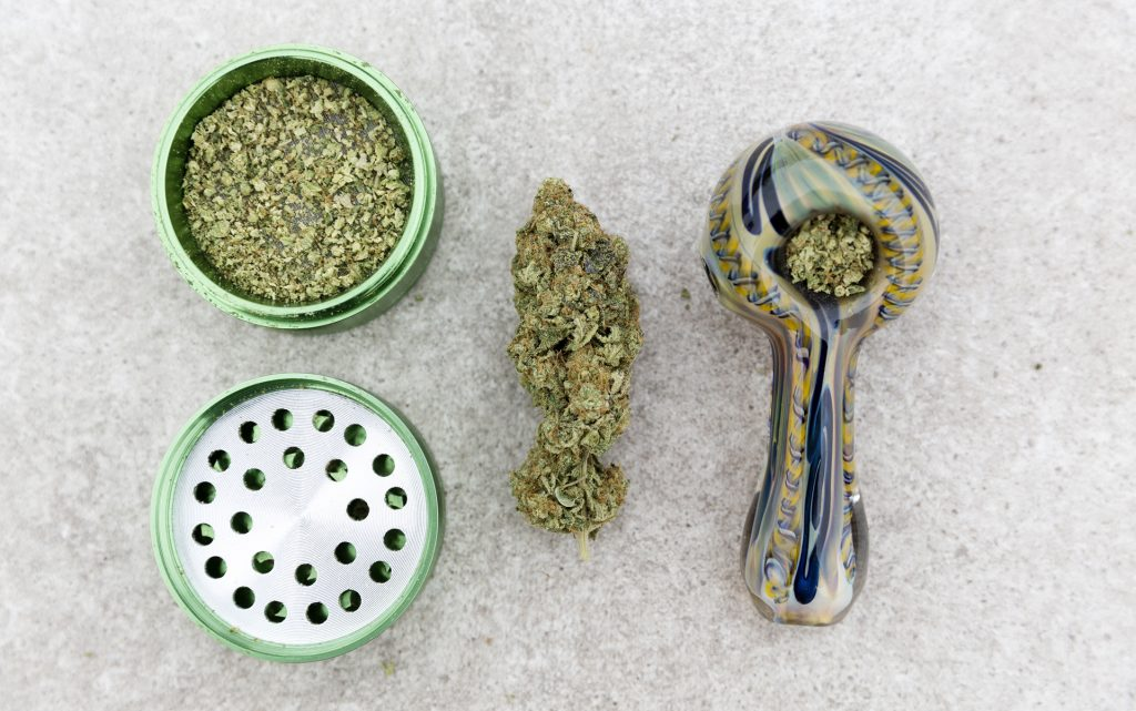 Marijuana Pipe, grinder and nug.