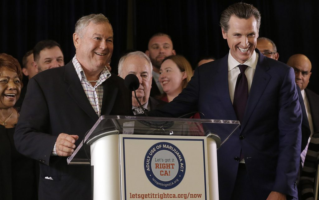 Rep. Dana Rohrabacher, R-Calif., left, smiles next to Lt. Gov. Gavin Newsom at a news conference after speaking in support of the Adult Use of Marijuana Act ballot measure in San Francisco, Wednesday, May 4, 2016. (AP Photo/Jeff Chiu)