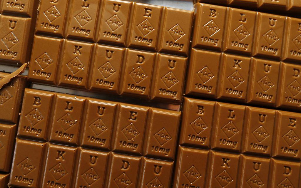 Chocolate bars marked with Colorado's new diamond-shaped stamp noting that the product contains cannabis. State officials require the stamp to be put directly on edibles after complaints that the treats look too much like their non-intoxicating counterparts. (AP Photo/David Zalubowski)