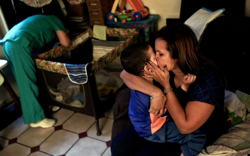 "Before going to a Halloween event at Jacel Delgadillo's daughter's school, she and Bruno share a moment together in the family's living room in Miami, FL on Friday, October 28, 2016. ""It's like magic now,"" Delgadillo said about how attentive Bruno has become, ""i honestly thought before that he didn't know I was his mom. I feel like he knows now."" By Scott McIntyre"