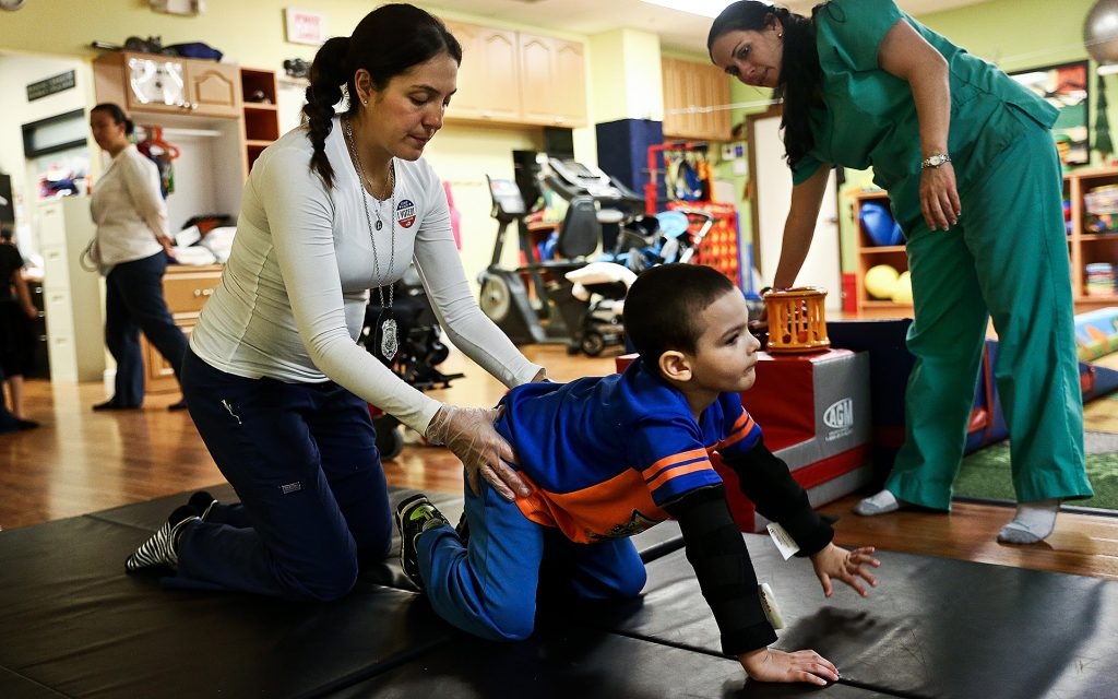 Occupational therapist Erika Bermeo helps to guide Bruno Stillo as he exercises his crawling during a therapy session at B&V Thera-Pro in Miami, FL on Friday, October 28, 2016. Before he began using medical marijuana, Bruno was mostly immobile. Since he started integrating it into his daily medication, his motor skills have improved and his epileptic seizures have drastically decreased. (Scott McIntyre for Leafly)