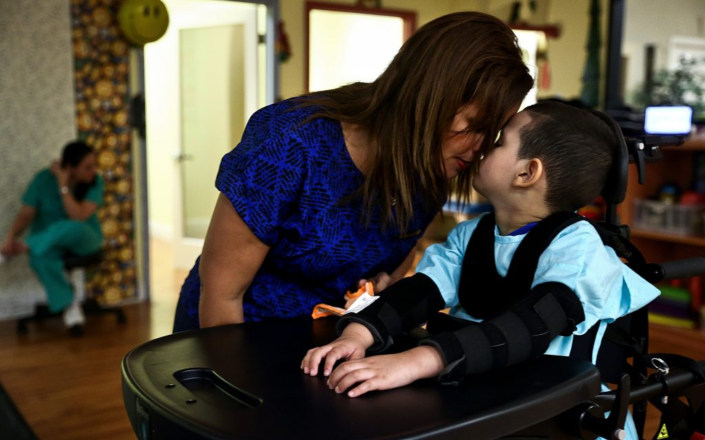 "In between therapy sessions, Jacel Delgadillo shares a moment with her son Bruno Stillo in Miami, FL on Friday, October 28, 2016. Stillo suffers from Dravet syndrome, a rare and catastrophic form of intractable epilepsy that begins in infancy. At one time, he would experience 300 seizures a day. In 2014, Delgadillo began using cannabis oil for her son's seizures and has gone from mostly immobile and non-responsive to being able to crawl and respond to his surroundings. ""We love to see how much he's grown and how much he's learned,"" said Delgadillo. By Scott McIntyre"