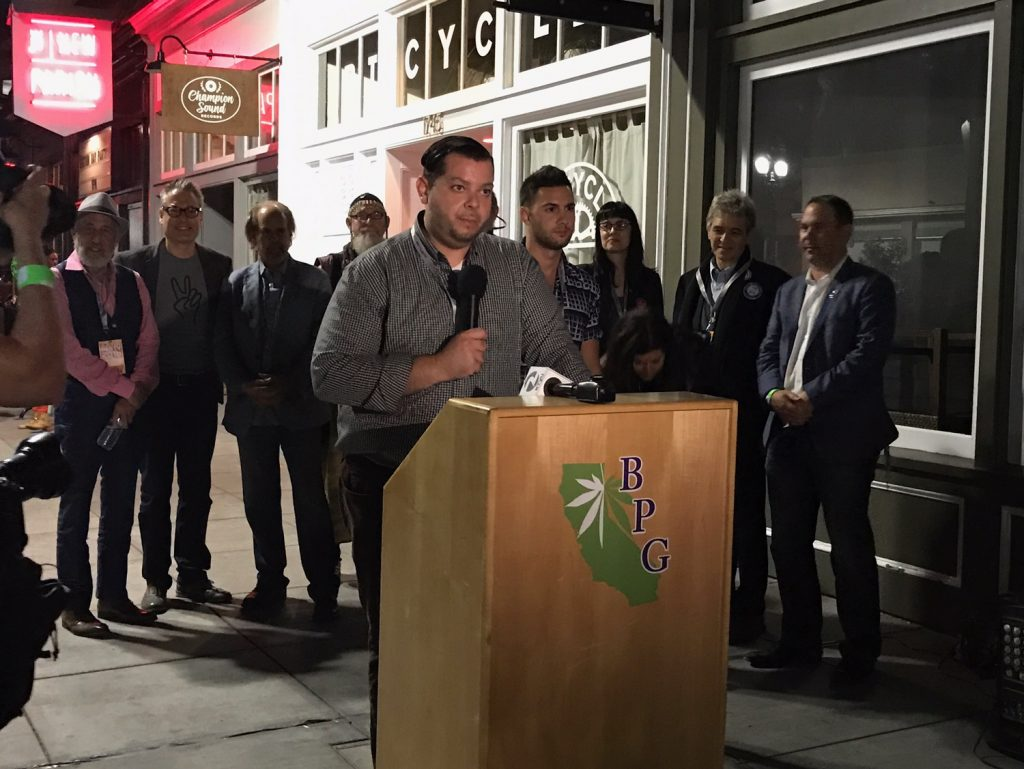 Outside a packed club in Oakland, Victor Pihno and other Prop. 64 backers announce that the election has been called: Recreational cannabis is officially legal in California. (Photo courtesy Dani Green)