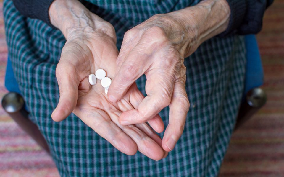 Grandma taking pills