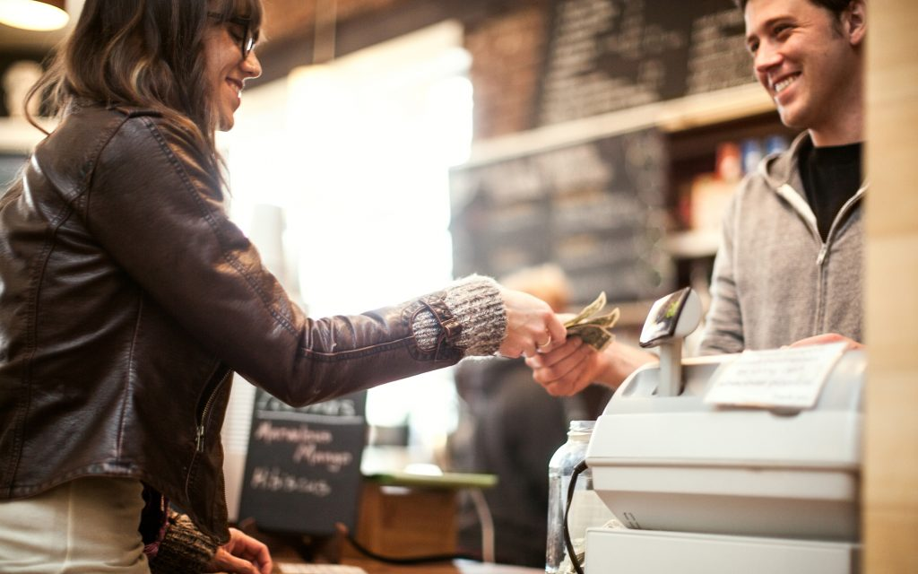 Young woman purchasing coffee