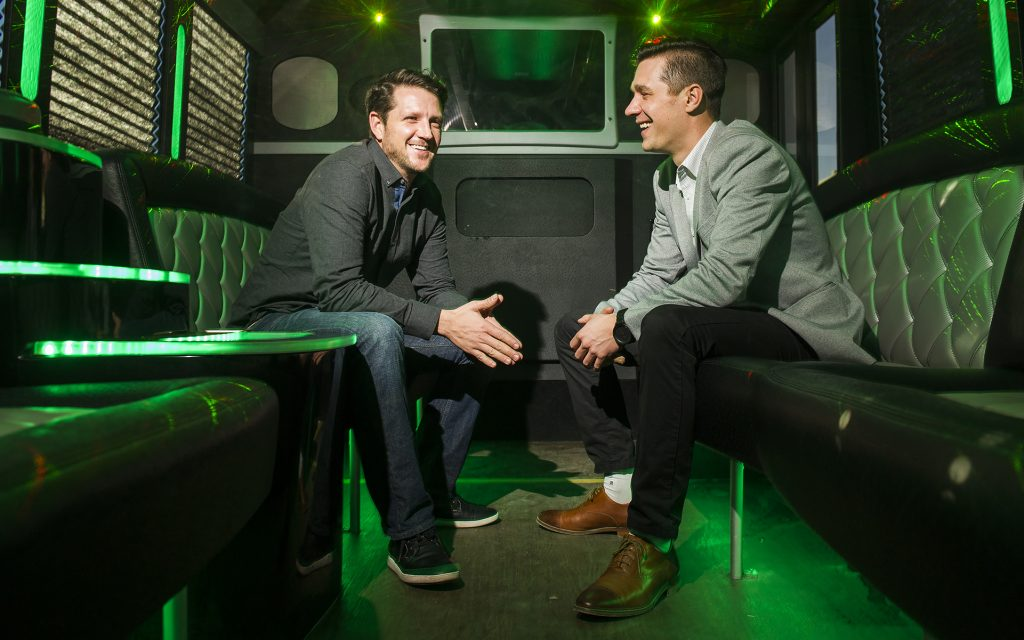 My 420 Tours CEO JJ Walker, left, and COO Danny Schaefer pose for a picture Thursday, Dec. 29 2016 on a transportation bus outside their office at 3881 Steele St #10 in Denver, CO. The two started operating a cannabism tourism experience in April 2013. Tours involve visits to grow houses, dispensaries, or a sushi, sake and joint rolling class. (Daniel Brenner for Leafly)