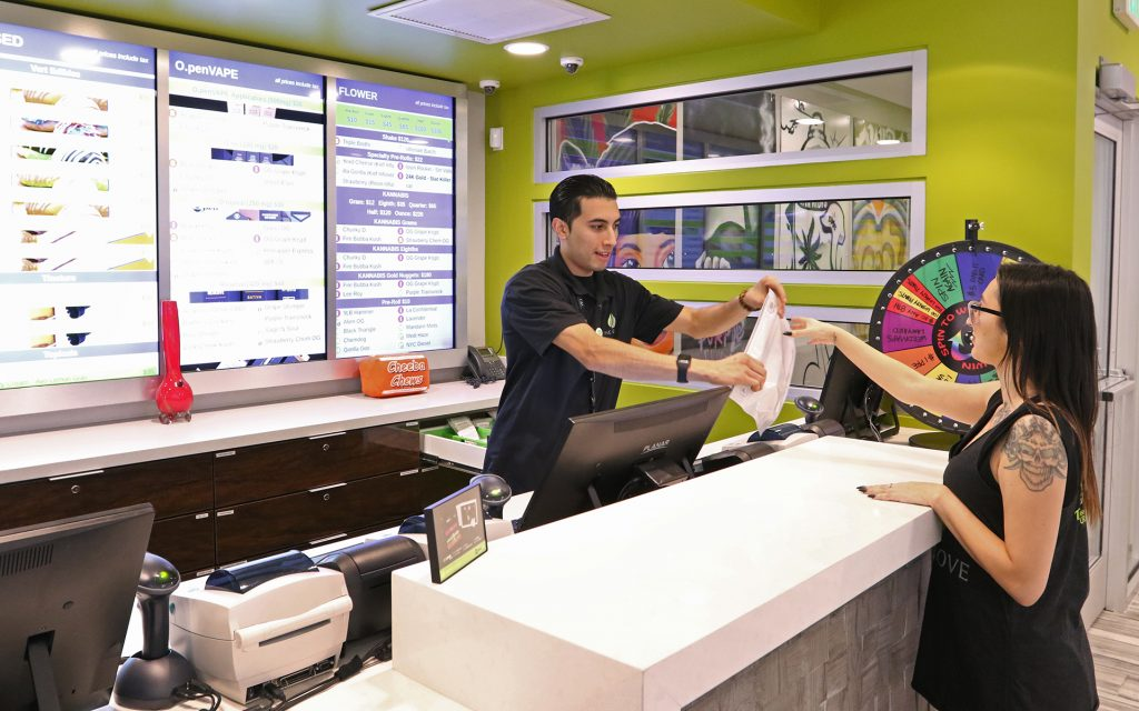 A budtender helps a customer at The Grove Wednesday, Jan. 11, 2016, in Las Vegas. (Ronda Churchill for Leafly)