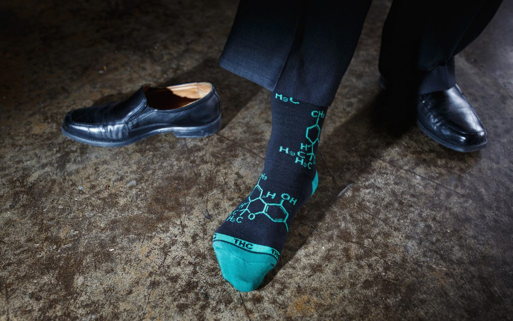Medical marijuana advocate Sebastien Cotte shows off his THC molecule socks. (Melissa Golden for Leafly)