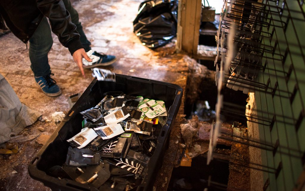Employee Aaron Zeitlin sorts through damaged and undamaged products. (Ramon Dompor for Leafly)