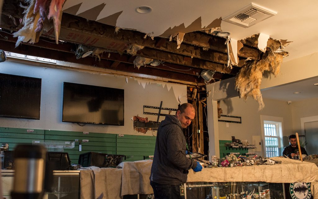 Owner Seth Simpson sorts through damaged products. (Ramon Dompor for Leafly)