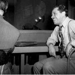 Jazz musician and band leader Cab Calloway is shown in the control room as he hears the playback of his first 1947 recording session with his orchestra at Columbia studio, New York City, March 12, 1947. (AP Photo)
