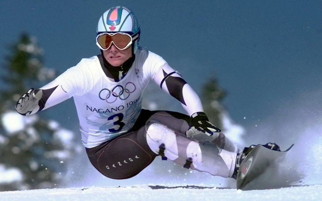 Ross Rebagliati of Canada skis to victory in the first-ever Men's Giant Slalom snowboarding competition Sunday Feb. 8, 1998 in Yamanouchi, Japan. (Robert F. Bukaty/AP)