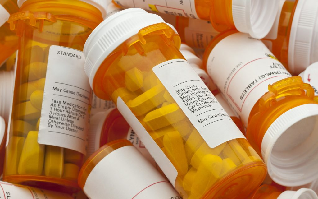 Several Prescription Pill Bottles in a Pile