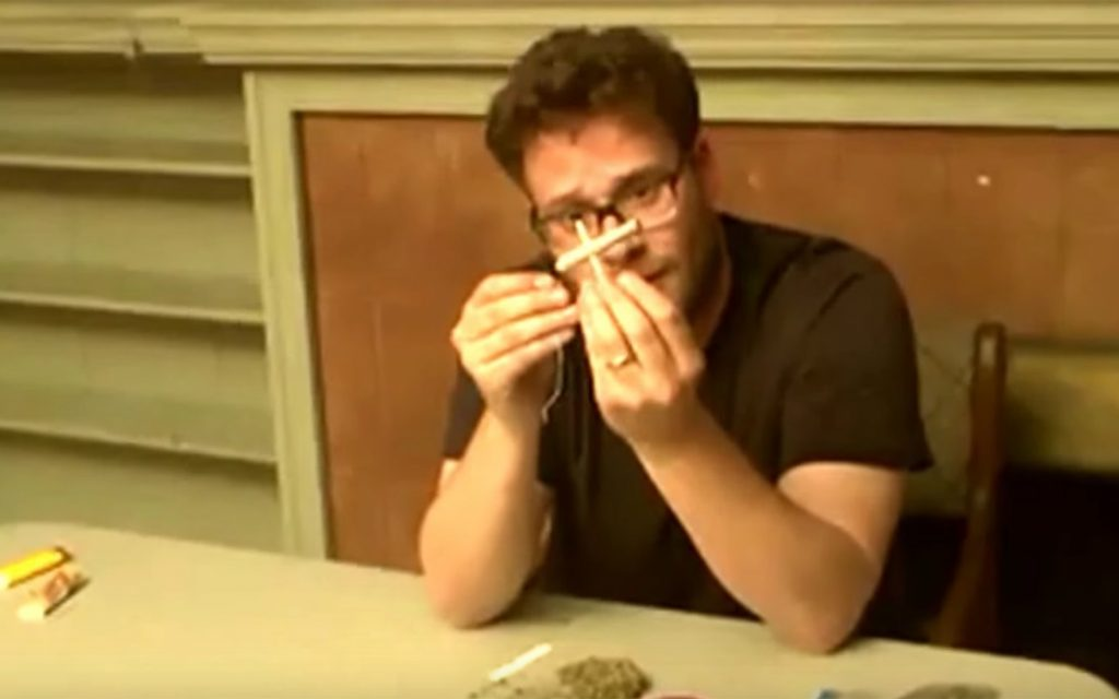 Seth Rogen showing off his cross joint