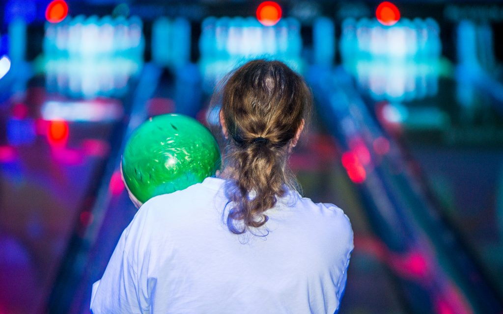 Robert Calkin lines up for a throw during The Big Lebongski Bowling Tournament. (Justin Stewart for Leafly)
