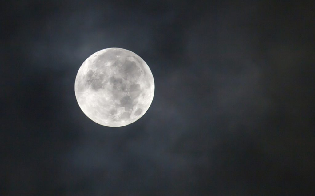 Close up of full moon in cloud