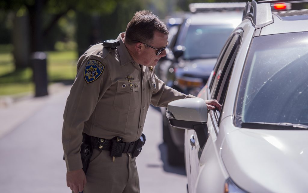 CHP officer Gary Martins conducts simulated traffic stop on Jaimi Kenyon, a CHP Sergent as members of the Highway Patrol and Sacramento Police Department simulate traffic stops involving drivers suspected of being under the influence of drugs and alcohol at the California State Capitol, Wednesday May 10, 2017. The demonstration will showed the current procedures used by law enforcement officers as well as new roadside drug testing technology that could be used in the future. Photo by photo by Brian Baer