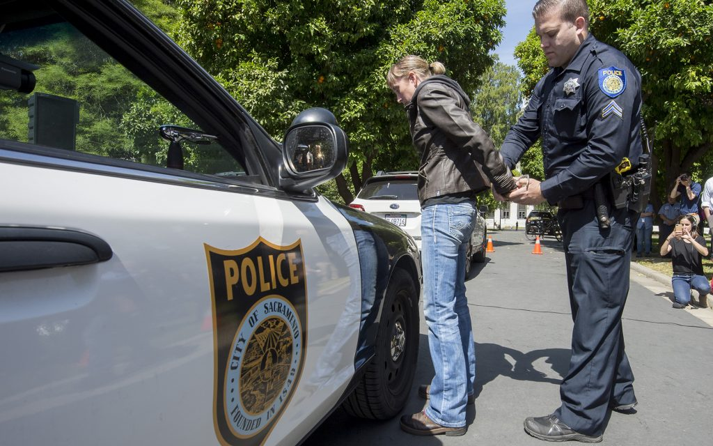 Sacramento Police officer Luke Moseley conducts simulated saliva field sobriety test on Jaimi Kenyon, a CHP Sergent as members of the Highway Patrol and Sacramento Police Department simulate traffic stops involving drivers suspected of being under the influence of drugs and alcohol at the California State Capitol, Wednesday May 10, 2017. The demonstration will showed the current procedures used by law enforcement officers as well as new roadside drug testing technology that could be used in the future. Photo by photo by Brian Baer