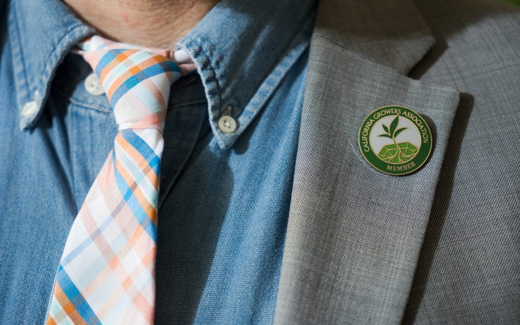 Hezekiah Allen's pin hints at his cause: Growing a legal industry with room for legacy growers.