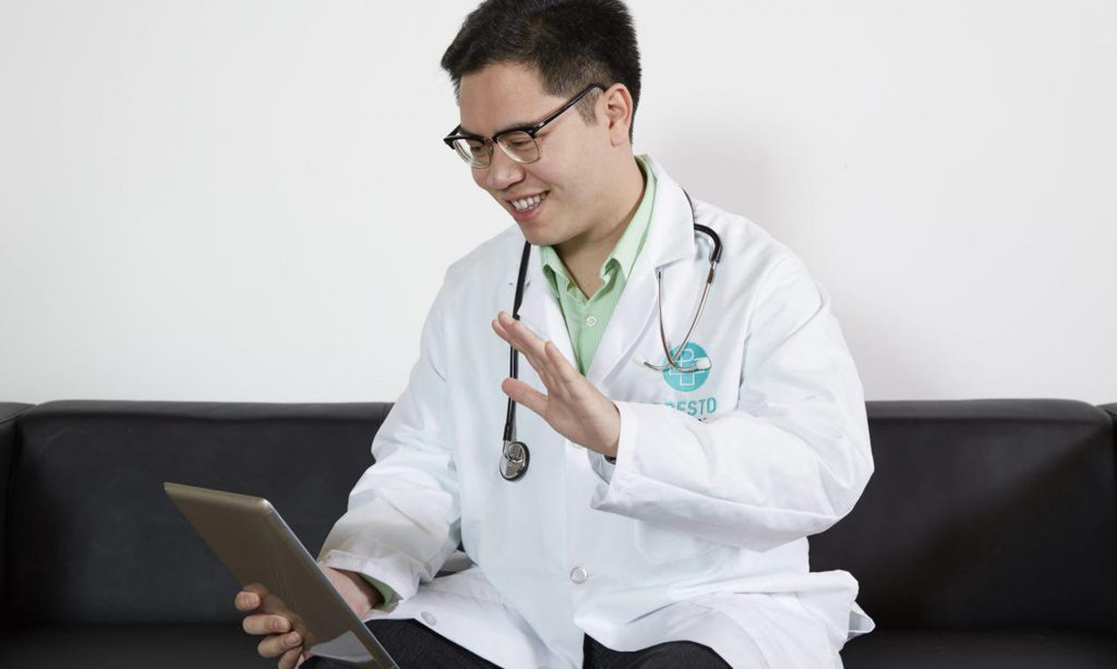 Dr. David Nguyen greeting a medical marijuana patient at a telemedicine appointment