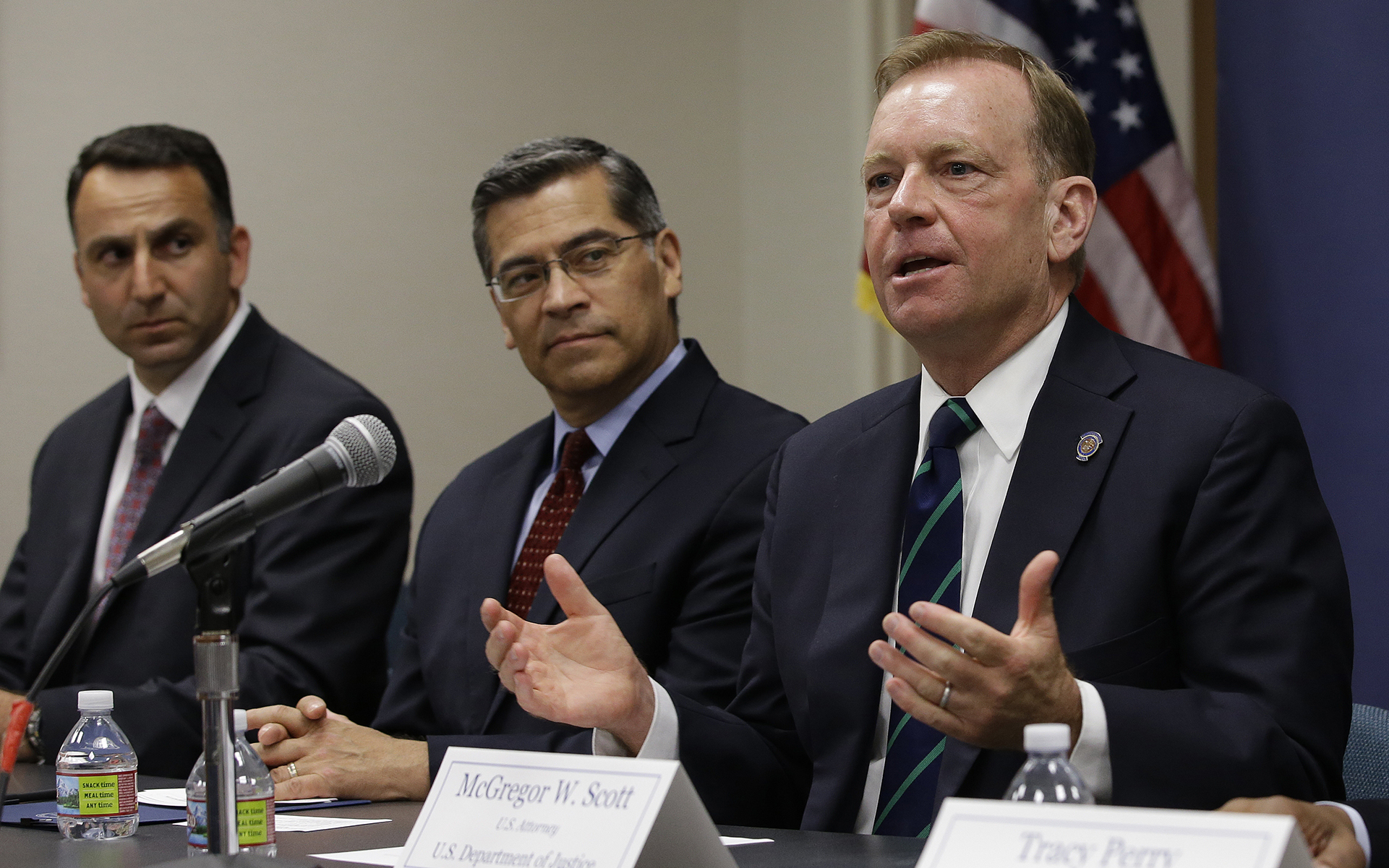 McGregor Scott, right, the United States Attorney for the Eastern District of California, flanked by California Attorney General Xavier Becerra, center, discusses an increase in the use of a banned pesticide at illegal marijuana farms hidden on public lands Tuesday, May 29, 2018, in Sacramento, Calif. Research by Mourad Gabriel, left, the executive director and senior ecologist at Integral Ecology Research Center, and his colleagues found the highly toxic pesticide Carbofuran, which can't legally be used in the Unites States, at 72 percent of grow sites last year, up 15 percent from 2012. (AP Photo/Rich Pedroncelli)