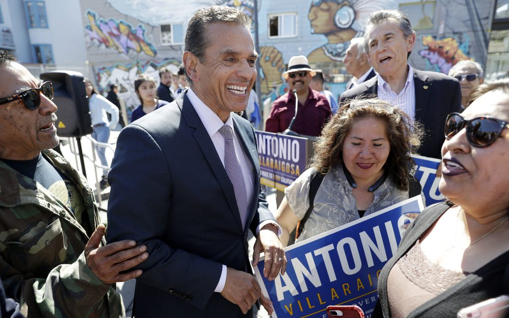 FILE - In this May 11, 2018 file photo Antonio Villaraigosa, the former mayor of Los Angeles, chats with constituents during a campaign stop in San Francisco. The heat for California governor is especially intense for Republican Cox and Democrat Antonio Villaraigosa, whom polls show to be in a tough fight for the second of two slots on the general election ballot. Democrat Gavin Newsom is the undisputed front-runner and is expected to advance. The primary is Tuesday, June 5, 2018, and more than 1.4 million ballots have already been cast by mail. (AP Photo/Marcio Jose Sanchez,File)