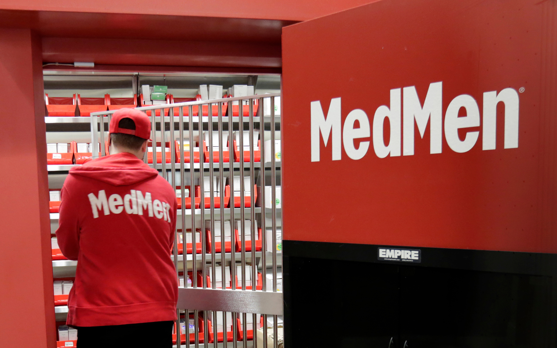 Rep. Ted Lieu opens a MedMen store in Venice Saturday. MedMen owns and operates licensed cannabis facilities in cultivation, manufacturing and retail. (AP Photo/Richard Drew)