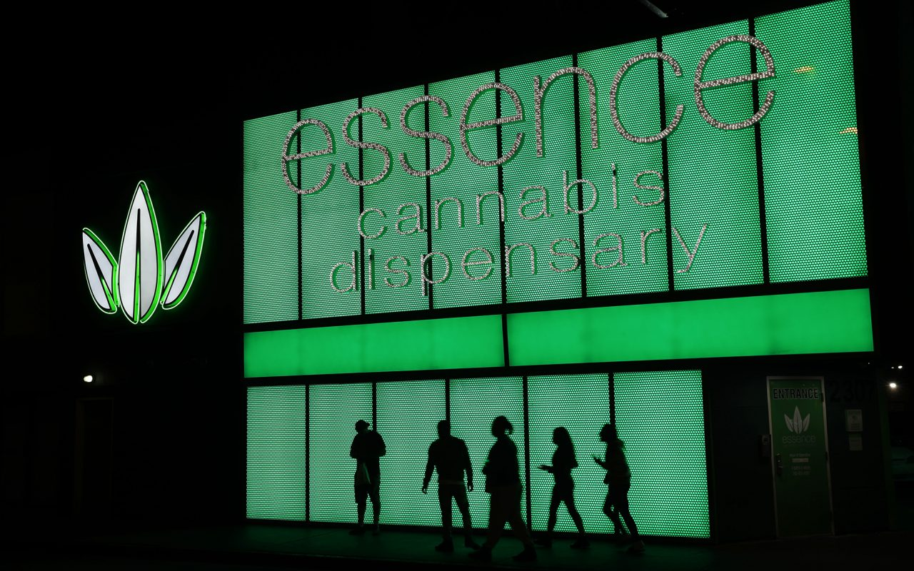 In this April 16, 2018, file photo, people stand outside after shopping at the Essence cannabis dispensary in Las Vegas. Nevada