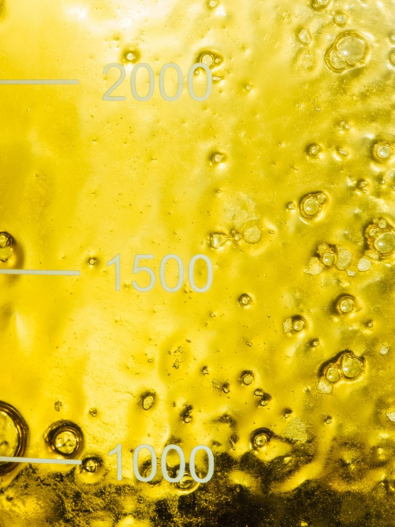 Heylo's cannabis extraction process: a glass of CO2 cannabis oil