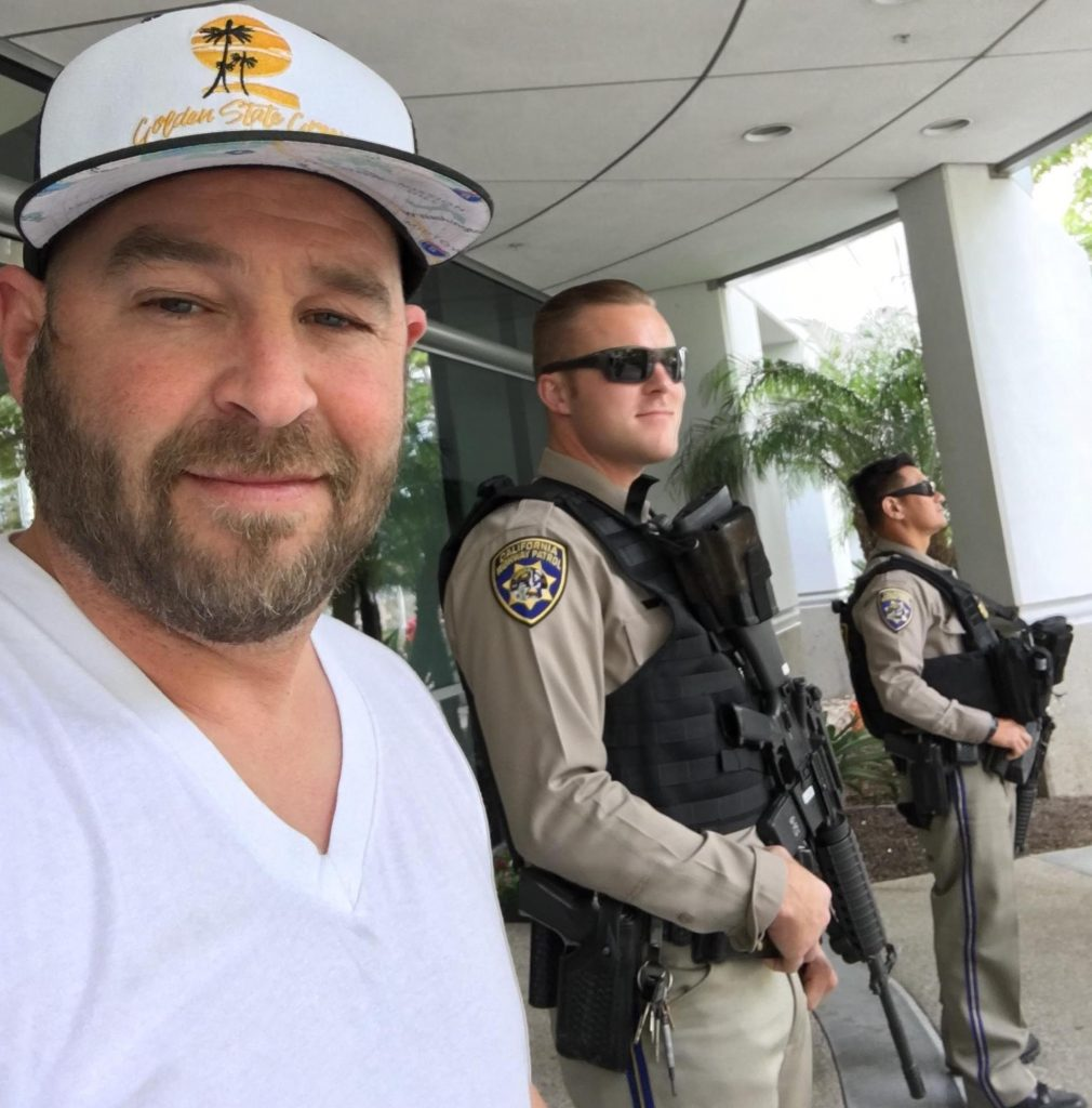 A San Diego cannabis operator pays his taxes at city hall as armed officers stand by. (Courtesy of Golden State Green)