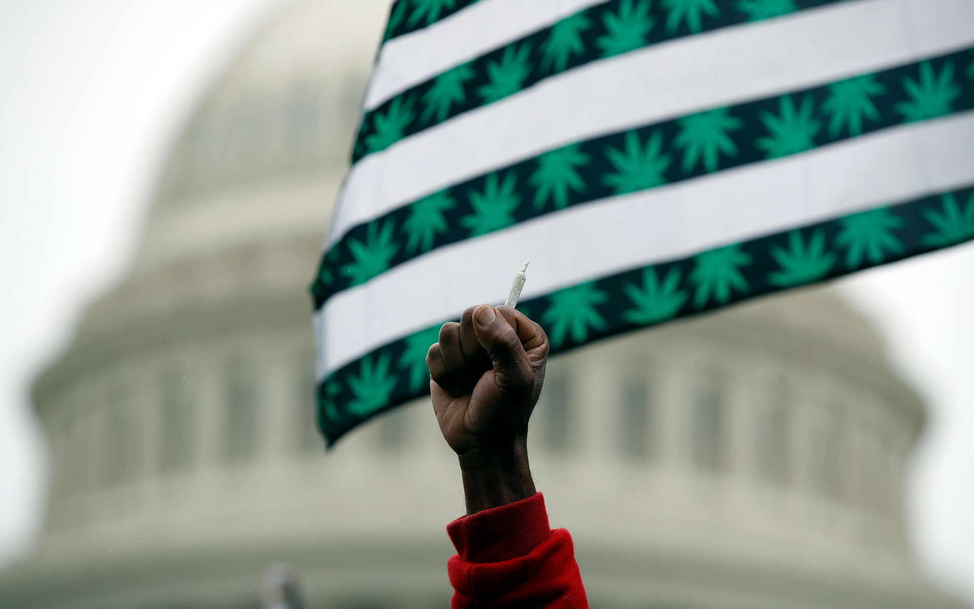 A man holds up a joint during a rally to support the legalization of marijuana on Capitol Hill, Monday, April 24, 2017 in Washington. Smoking pot in public remains illegal everywhere in Washington. (Alex Brandon/AP)