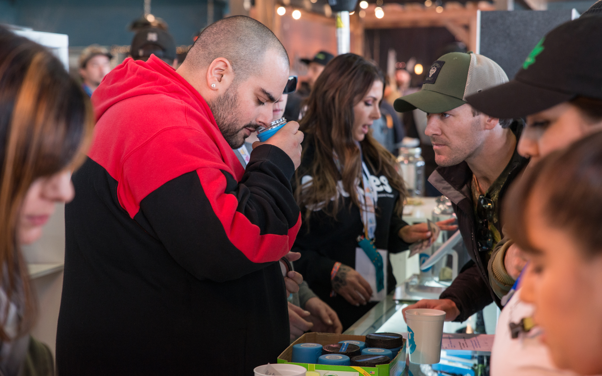 (Hundreds of vendors offer bargains on fresh outdoor cannabis flowers and seeds. Above, cannabis mogul Berner inspects the wares. (Courtesy Emerald Cup))