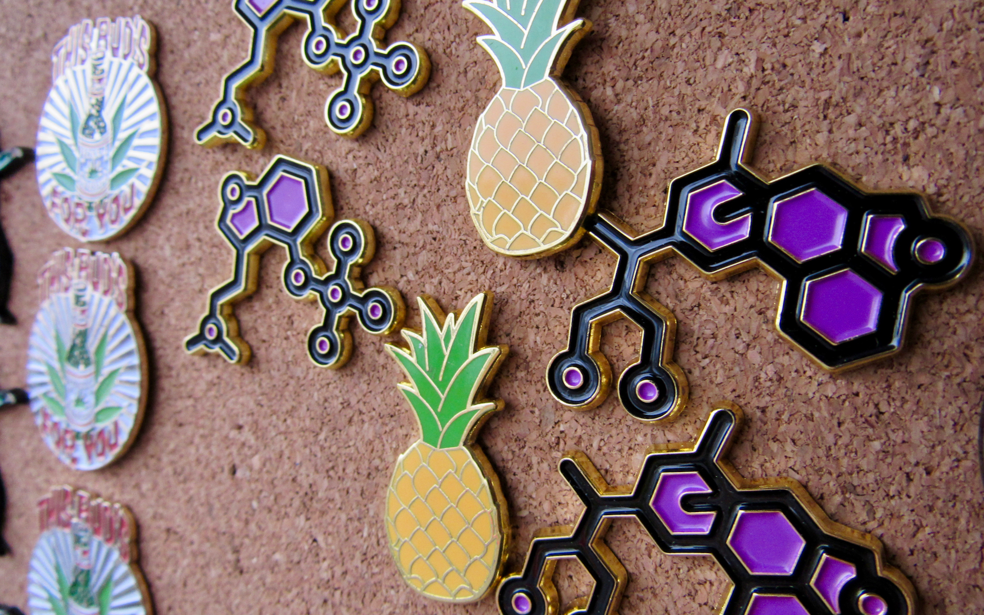 Hat pins in the shape of THC molecules and pineapples sold for $15 each. (David Downs/Leafly)