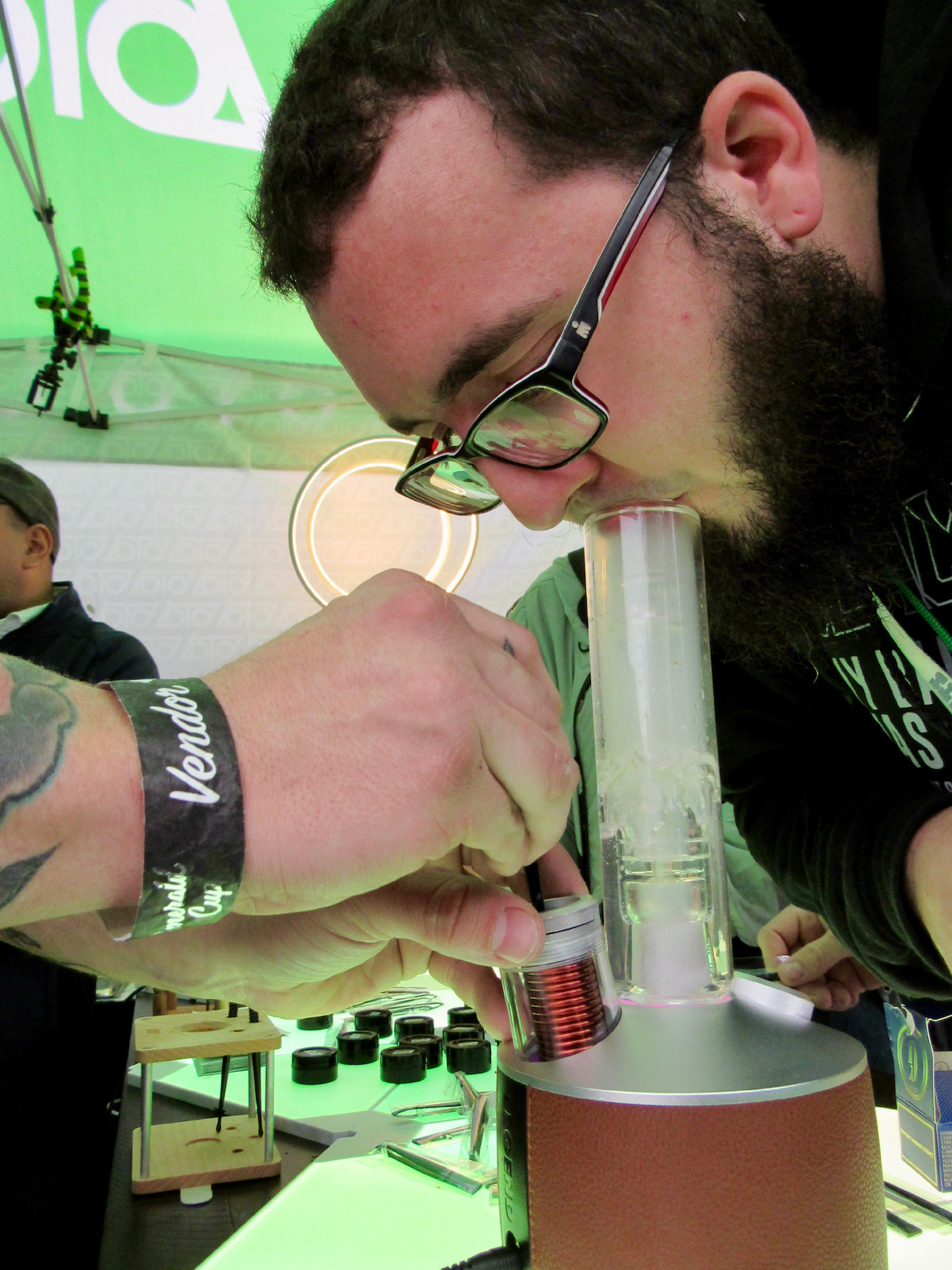 Wookie Tech: A contestant hits hash vapor from the new, $400, Loto Legend magnetic induction dab rig, which debuted at the Cup. (David Downs/Leafly)