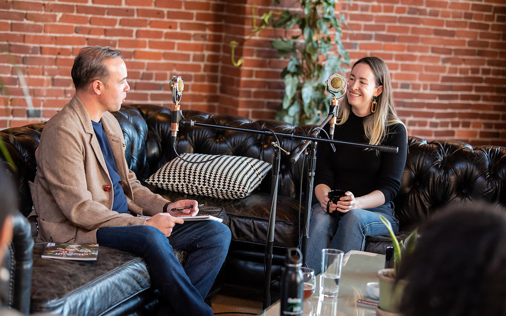 Broccoli founder Anja Charbonneau, with The Hash podcast co-host David Downs, at Listen Up Portland Feb. 17. (Photo by Casey Campbell | Courtesy Listen Up Portland)