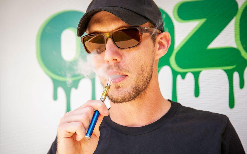 man using Ooze cannabis vape pen