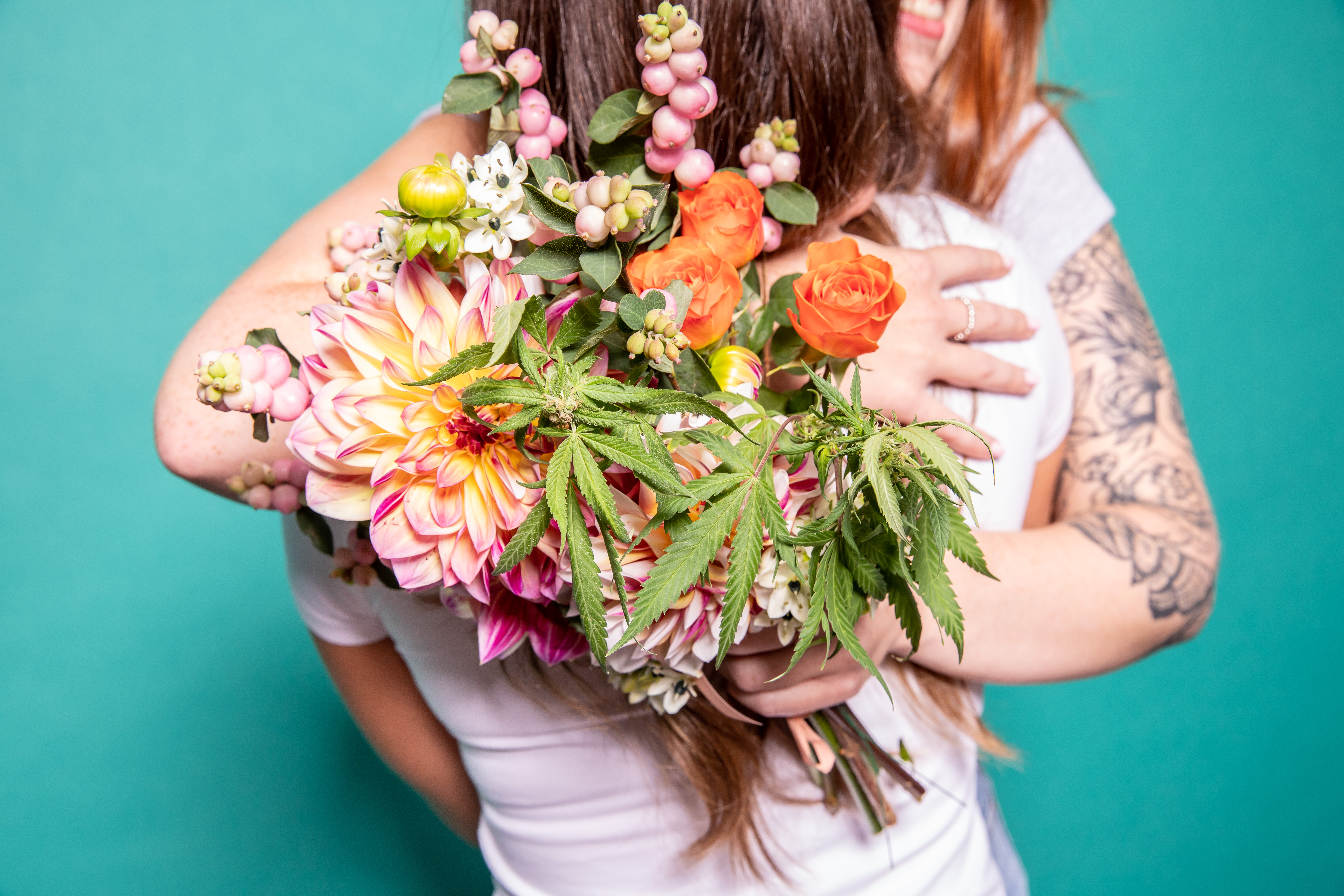 party etiquette, people hugging with bouquet of cannabis flowers
