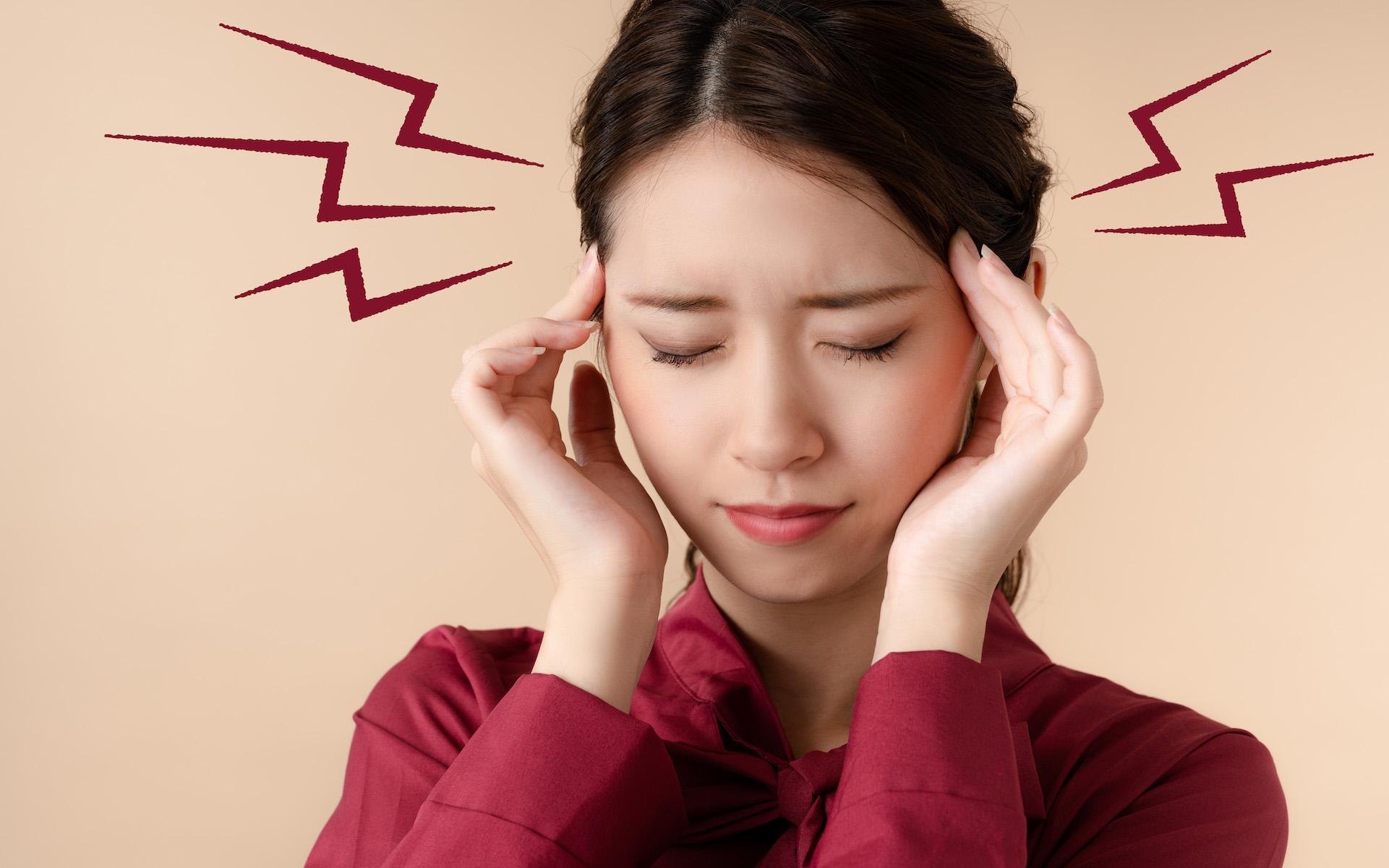 cannabis topicals headache migraine; woman rubbing temples