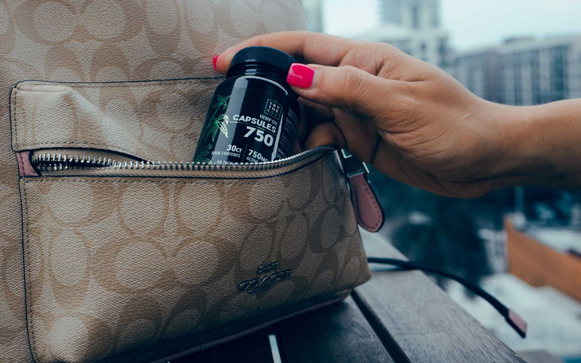 Woman pulling Try the CBD capsules out of her purse