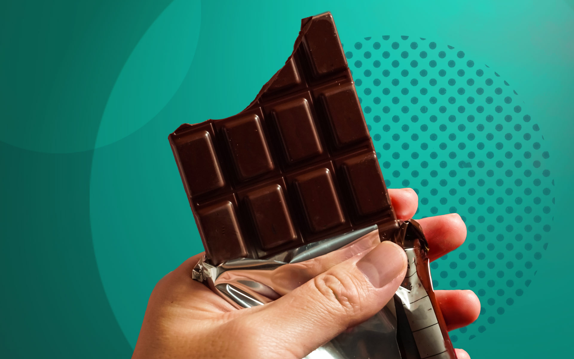 cannabis edibles guide; hand holding chocolate bar