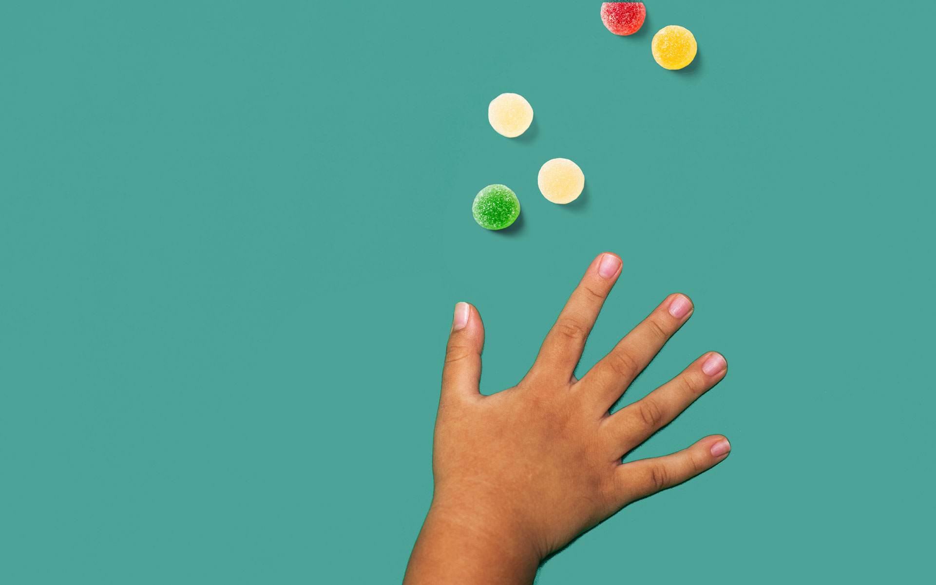 child's hand reaching for candy ;what happens when kids eat marijuana edibles
